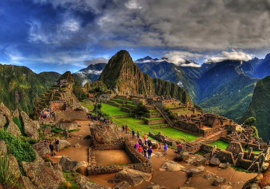 Machu Picchu is an Incan citadel set high in the Andes Mountains in Peru, above the Urubamba River valley. Built in the 15th century and later abandoned, it's renowned for its sophisticated dry-stone walls that fuse huge blocks without the use of mortar, intriguing buildings that play on astronomical alignments and panoramic views