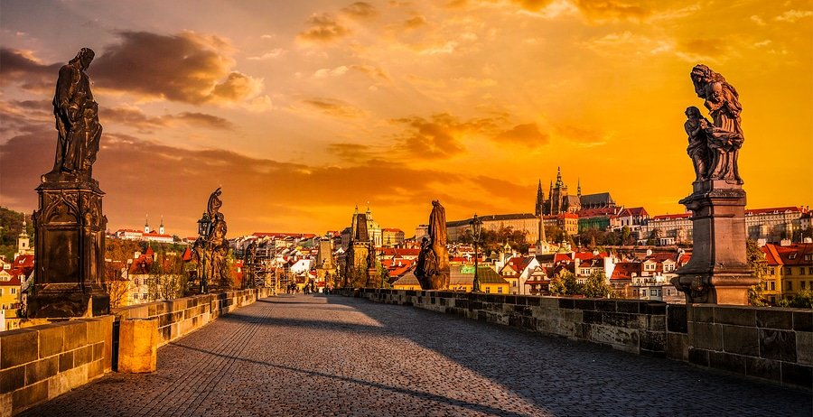 Panorama of Charles bridge and its statues and Prague castle on surise. Prague, Czech Republic